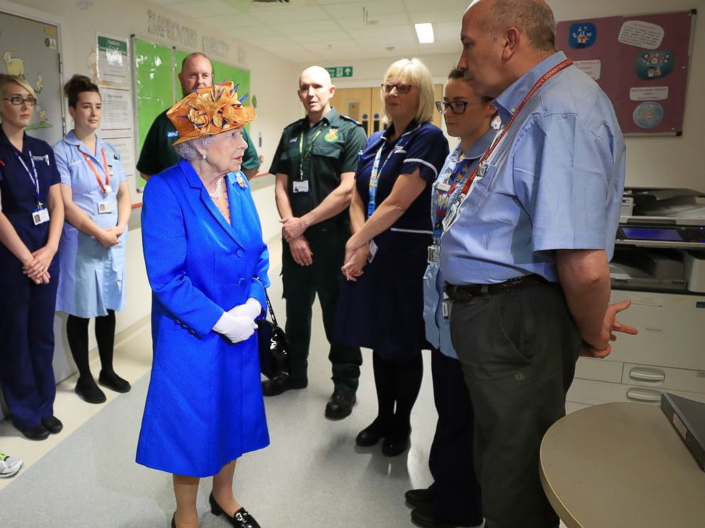 PHOTO:Britains Queen Elizabeth II speaks with hospital personnel as she visits the Royal Manchester Childrens Hospital to meet victims and to thank members of staff who treated them, May 25, 2017.