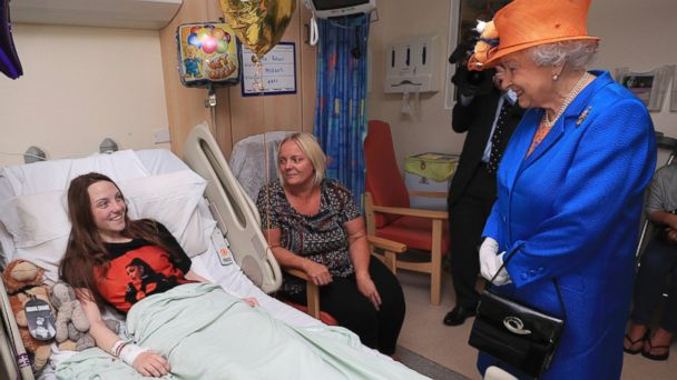 PHOTO: Britain's Queen Elizabeth II. right,  speaks to Millie Robson, 15, and her mother, Marie, as she visits the Royal Manchester Children's Hospital in Manchester England, to meet victims and to thank members of staff who treated them, May 25, 2017.