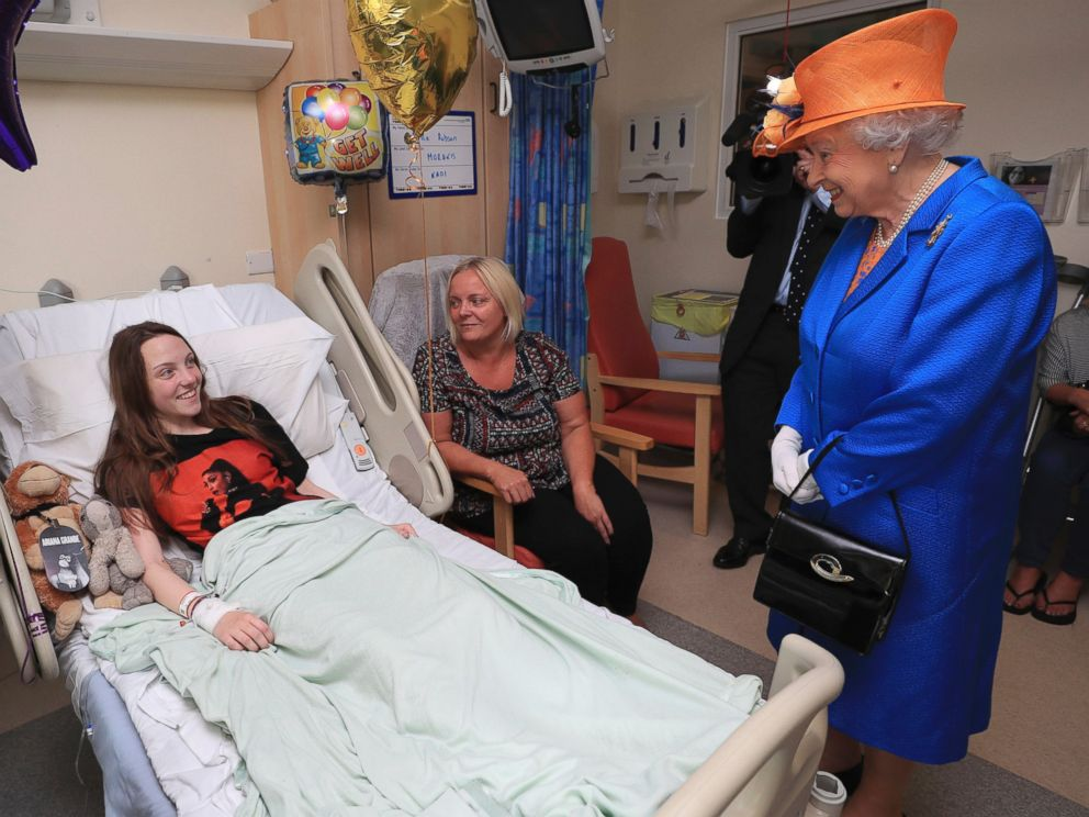 PHOTO: Britains Queen Elizabeth II. right, speaks to Millie Robson, 15, and her mother, Marie, as she visits the Royal Manchester Childrens Hospital in Manchester England, to meet victims and to thank members of staff who treated them, May 25, 2017.