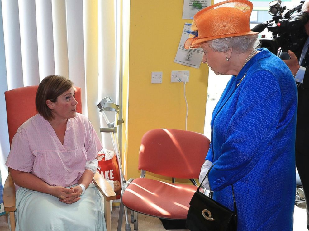 PHOTO: Britains Queen Elizabeth II, right, speaks to Ruth Murrell during the Queens visit to the Royal Manchester Childrens Hospital in Manchester England, to meet victims, May 25, 2017.