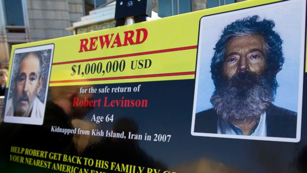 PHOTO: In this Tuesday, March 6, 2012 file photo, an FBI poster showing a composite image of former FBI agent Robert Levinson, right, of how he would look like now after five years in captivity.