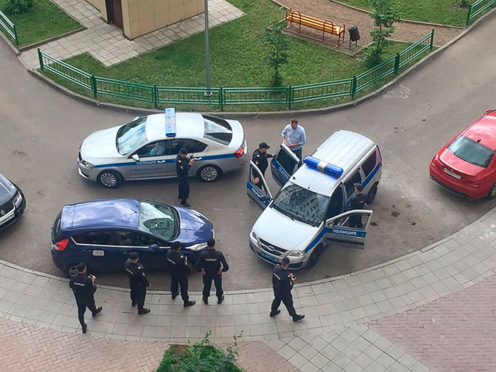 PHOTO: Alexei Navalny, blue shirt, is detained by police outside his apartment in Moscow, June 12, 2017. <p itemprop=