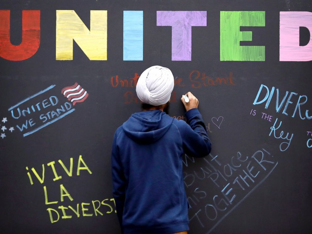 PHOTO: Texas A & M student Harsimran Singh, from India, signs a message board outside Kyle Field where an Aggies United event is scheduled at Texas A & M University, Dec. 6, 2016, in College Station, Texas.