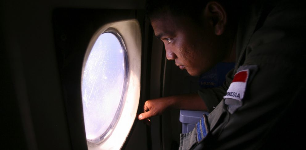 PHOTO: An Indonesian Navy crew member scans the water bordering Indonesia, Malaysia and Thailand during a search operation for the missing Malaysian Airlines Boeing 777 near the Malacca straits on Monday, March 10, 2014.