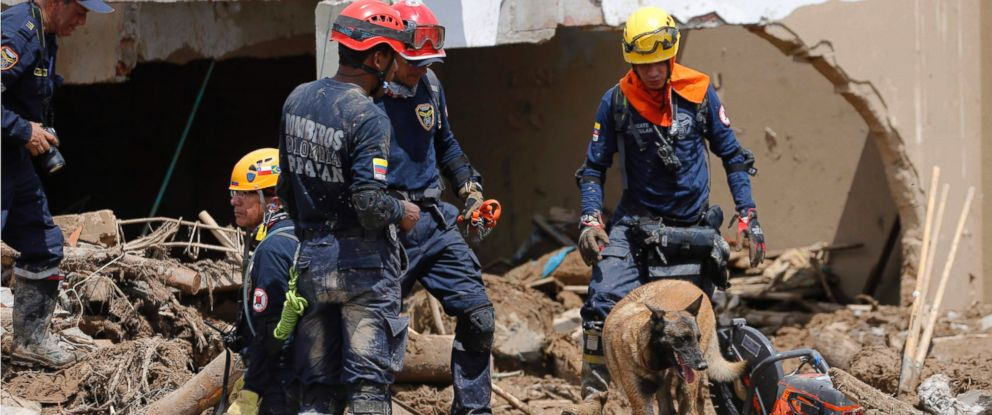 PHOTO: Firefighters search for survivors in Mocoa, Colombia, Sunday, April 2, 2017.