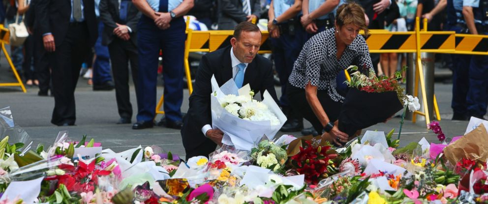 PHOTO: Australian Prime Minister Tony Abbott and his wife Margie pay their respect to the victims of the siege in Martin Place in Sydney central business district, Australia, Dec. 16, 2014.