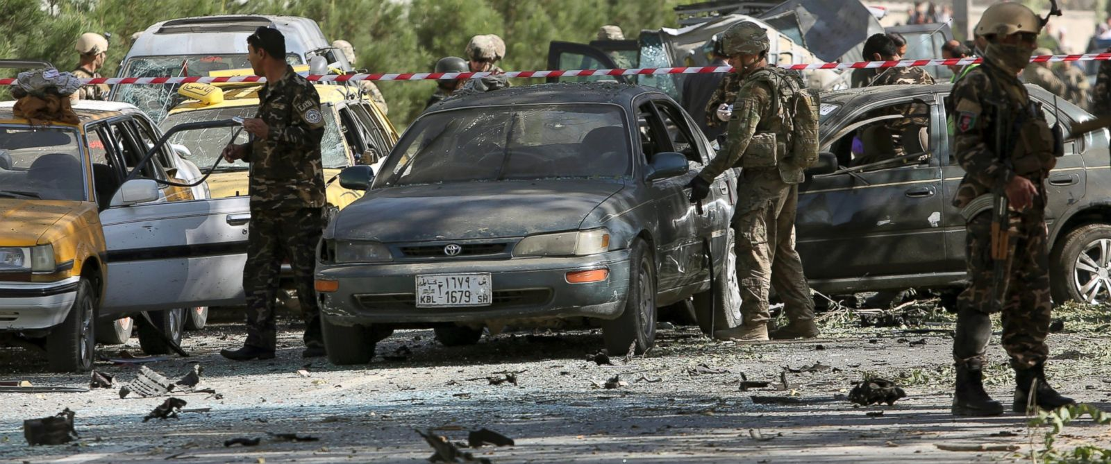 PHOTO: NATO and Afghan security forces inspect the site of a suicide attack in Kabul, Afghanistan, Sept. 16, 2014.