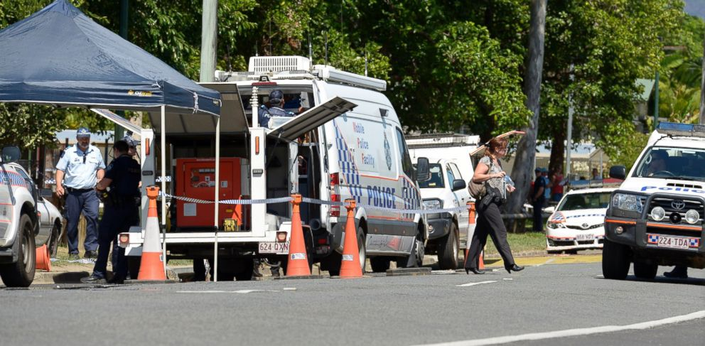 PHOTO: Police block the road outside a house where eight children have been found dead in a suburb of Cairns in far north Queensland, Australia, Dec. 19, 2014.
