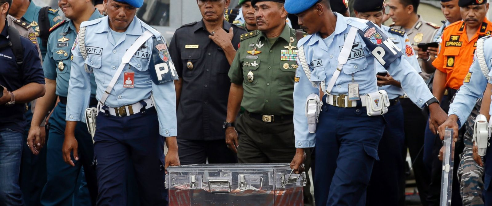 PHOTO:Indonesian air force personnel carry the flight data recorder of the ill-fated AirAsia Flight 8501 at an airport in Indonesia, Jan. 12, 2015.