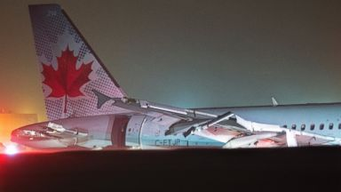 Air Canada flight 624 rests off the runway after landing at Stanfield International Airport in Halifax, Canada on Sunday, March. 29, 2015. Air Canada says at least 22 people were taken to hospital. The flight had 132 passengers and five crew members.