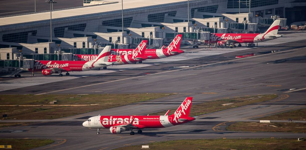 In this Nov 26, 2014 photo, AirAsia Airbus A320-200 passenger jets are seen on the tarmac at low cost terminal KLIA2 in Sepang, Malaysia.