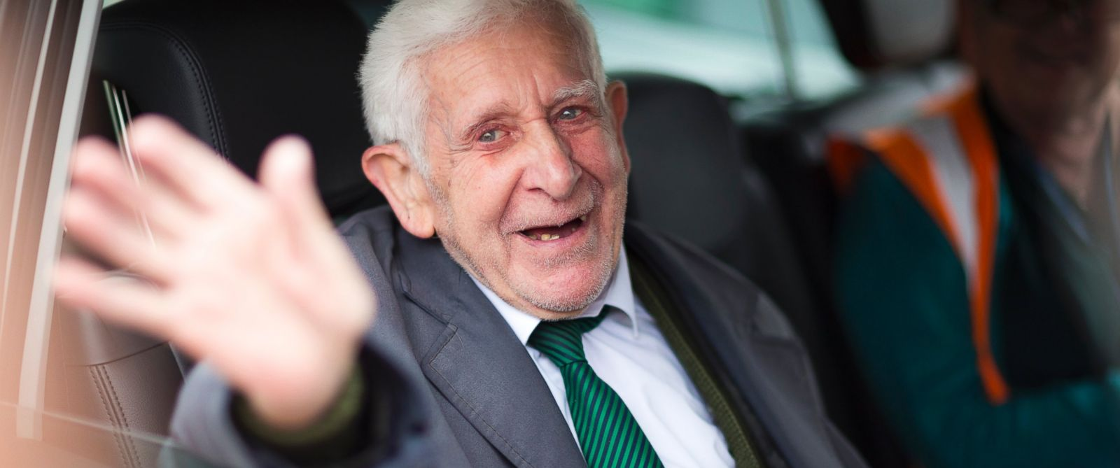 PHOTO: Bernard Jordan, gestures, as he is driven home after returning from Normandy on a Brittany Ferry, in Portsmouth, England, Saturday June 7, 2014.