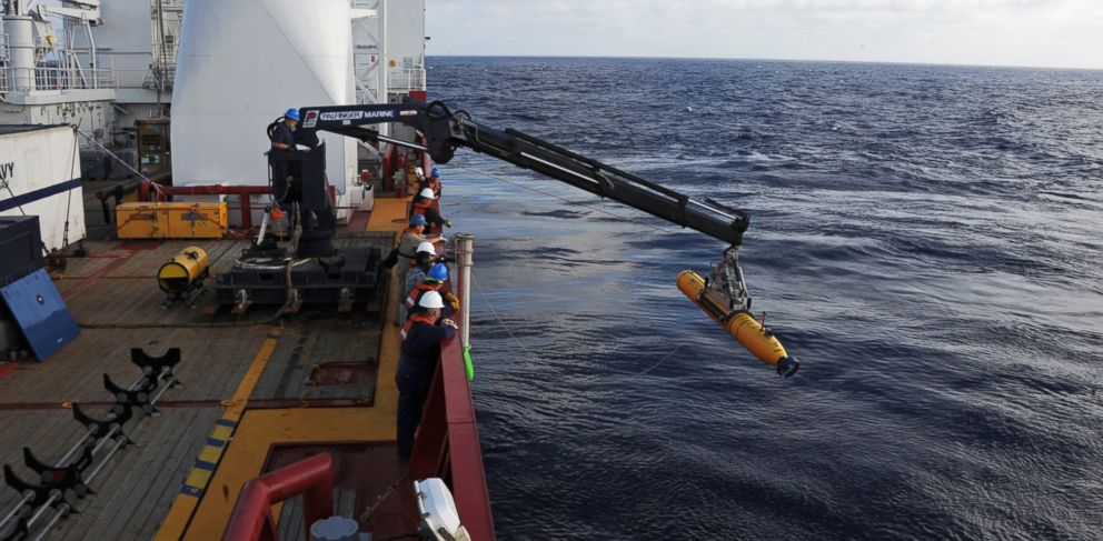 PHOTO: Operators aboard the Australian defense vessel Ocean Shield move the U.S. Navys Bluefin-21 autonomous underwater vehicle into position for deployment to search for the missing Malaysia Airlines Flight 370, April 14, 2014.