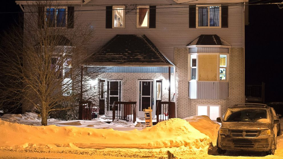 A car is parked outside a home on Tiger Maple Drive in Timberlea, Nova Scotia, a Halifax suburb, where police found a deceased person Friday, Feb. 13, 2015.