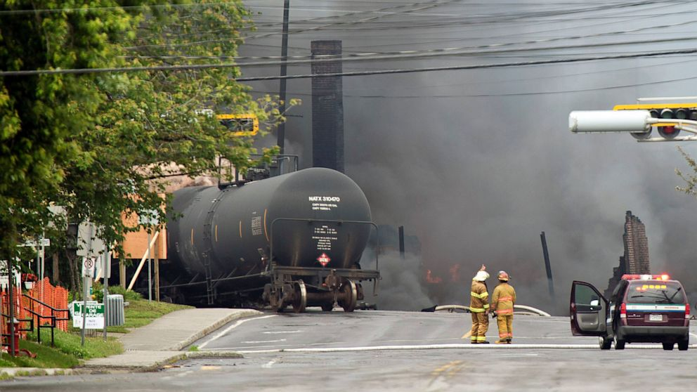 PHOTO: Smoke rises from railway cars that were carrying crude oil after derailing in downtown Lac Megantic, Quebec, Canada, Saturday, July 6, 2013. The derailment sparked several explosions and forced the evacuation