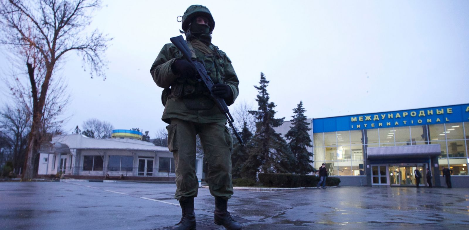 PHOTO: An armed man patrols a square in front of the airport in Simferopol, Ukraine, on Friday, Feb. 28, 2014.