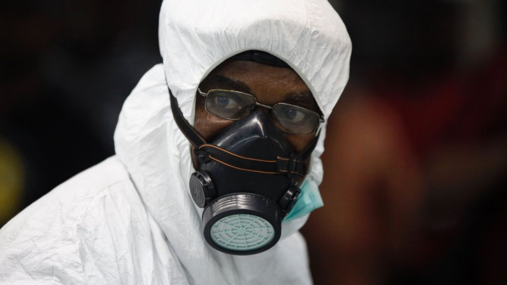 PHOTO: A Nigerian port health official wears protective gear at the arrivals hall of Murtala Muhammed International Airport in Lagos, Nigeria, Aug. 6, 2014.