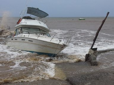 PHOTO:A boat sits in shallow water as Tropical Storm Erika passes through, Aug. 27, 2015, in New Town, Dominica.