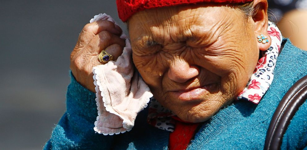 PHOTO: Mother of Nepalese mountaineer Ang Kaji Sherpa, killed in an avalanche on Mount Everest, cries while she waits for his body at Sherpa Monastery in Katmandu, Nepal, Saturday, April 19, 2014.