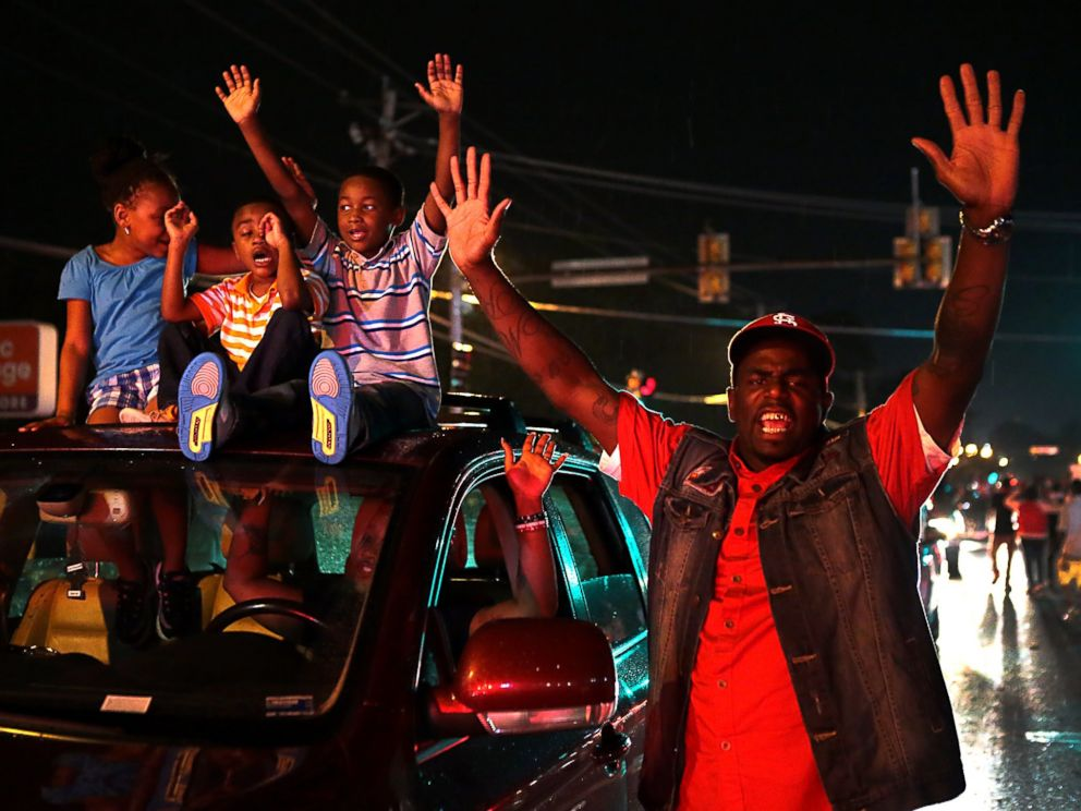 PHOTO: A sea of cars continued to roll down West Florissant Avenue in Ferguson as families protesting the killing of Michael Brown were plentiful on Friday, Aug. 15, 2014.