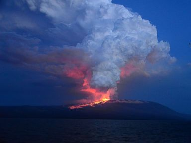 PHOTO: In this photo provided by Diego Paredes, guide of La Pinta Yatch Expedition, shows Wolf volcano erupting, at Isabela Island, Galapagos Islands, Ecuador, May 25, 2015.