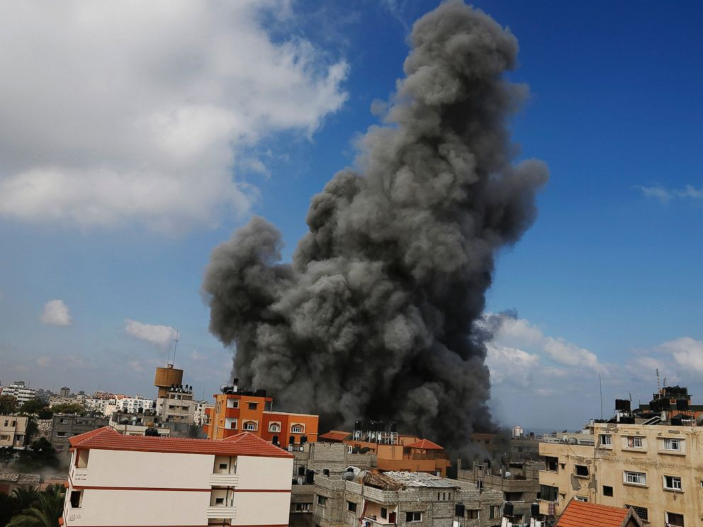 PHOTO: Smoke rises after an Israeli strike hit the offices of the Hamas movements Al-Aqsa satellite TV station, in Gaza City, northern Gaza Strip, July 31, 2014.