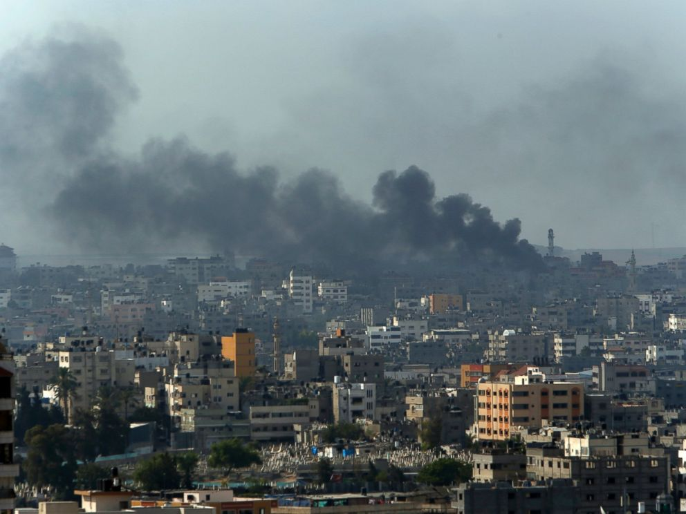 PHOTO: Smoke from Israeli strikes rise over Gaza City, northern Gaza Strip, July 21, 2014.