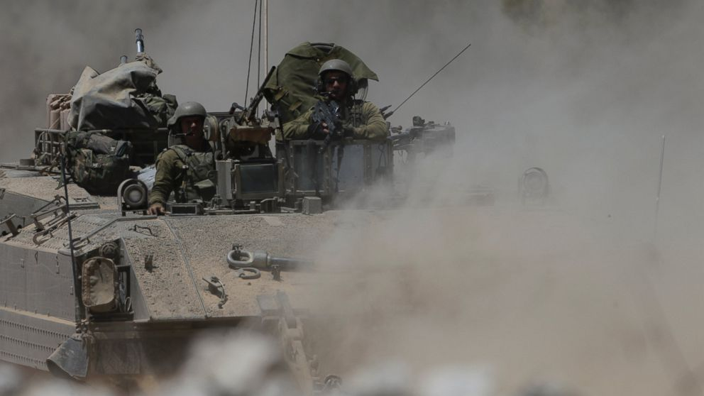 PHOTO: Israeli reserve soldiers are seen on the top of an armored personnel carrier returning to Israel from Gaza Strip, southern Israel, Aug. 4, 2014.