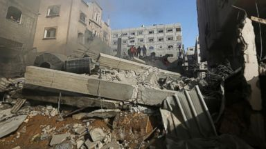 PHOTO: Palestinians inspect the rubble of a house after it was hit by an Israeli missile strike in Gaza City, July 10, 2014.