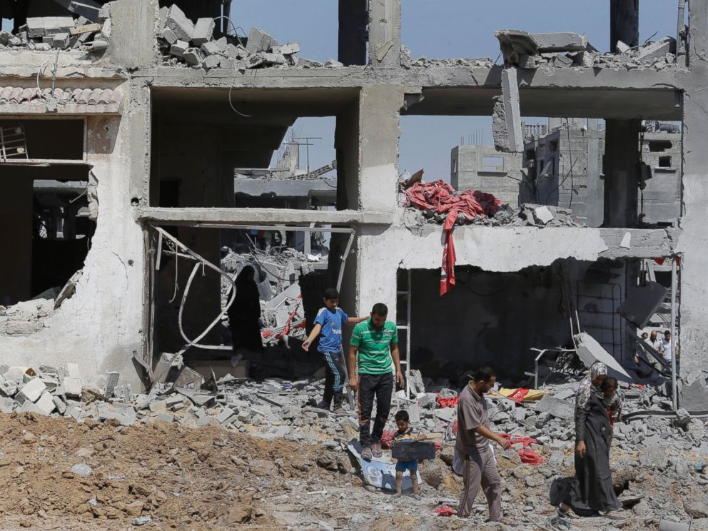 PHOTO: Palestinians carry their belongings after salvaging them from their destroyed house in the heavily bombed town of Beit Hanoun, Gaza Strip, Aug. 1, 2014.