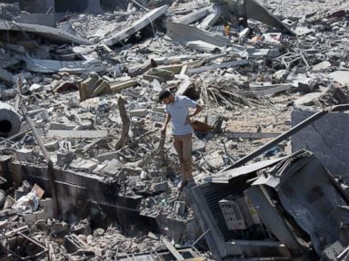 PHOTO: A Palestinian inspects a destroyed house in the heavily bombed Gaza City neighborhood of Shijaiyah, close to the Israeli border, Aug. 1, 2014.