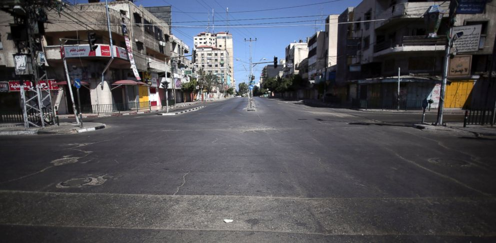 PHOTO: In this Friday, July 11, 2014 photo, a main street is empty in Gaza City.