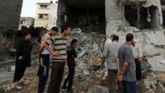 PHOTO: Palestinians gather outside the damaged house of Gazas police chief Taysir al-Batsh after it was hit by an Israeli missile strike in Gaza City, Sunday, July 13, 2014.