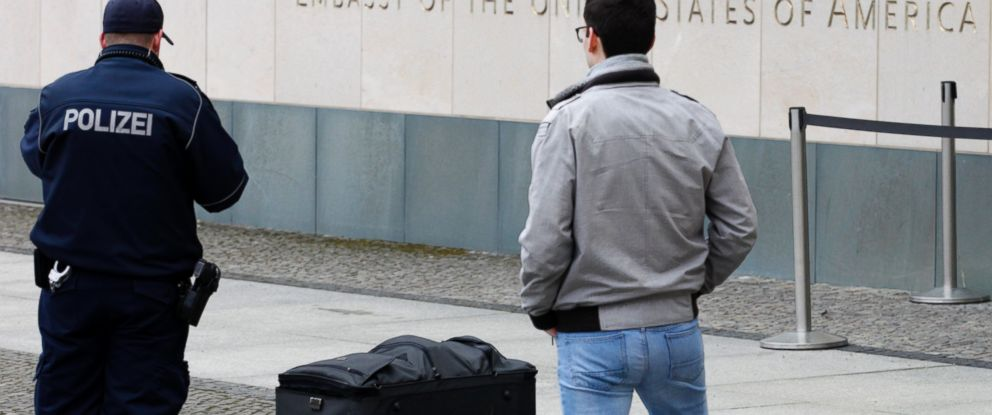 PHOTO: Police officers photograph a suitcase in front of the US embassy in Berlin, Germany, Friday, March 11, 2016.