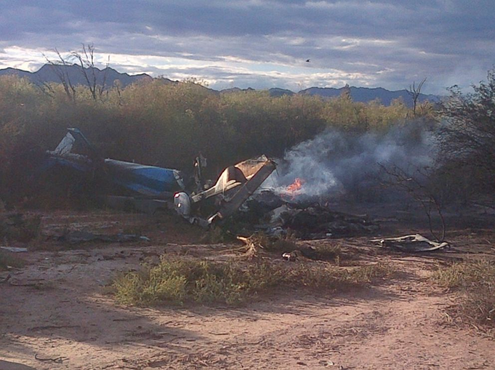 PHOTO: A man stands near one of two helicopters that crashed near Villa Castelli in the La Rioja province of Argentina, March 9, 2015.