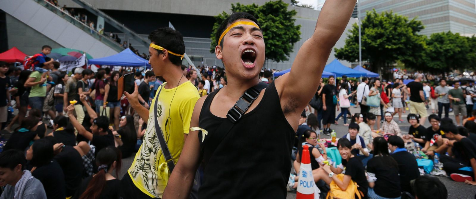 PHOTO: A pro-democracy activist shouts slogans on a street near the government headquarters where protesters have made camp, Oct. 1, 2014 in Hong Kong.