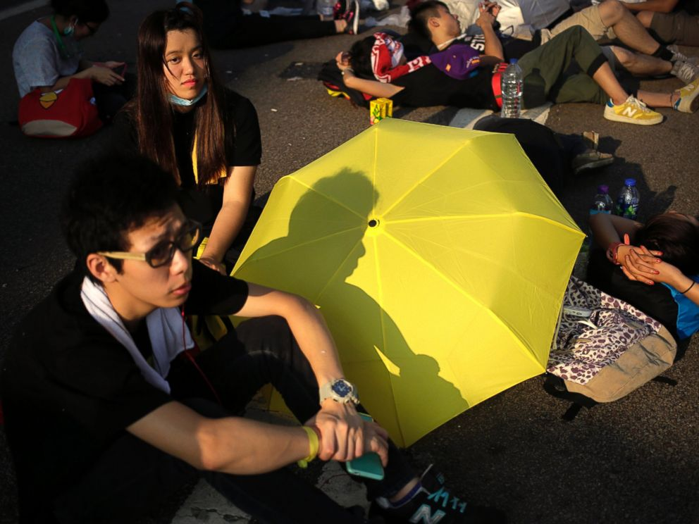 PHOTO: Student activists sleep on a road near the government headquarters where pro-democracy activists have gathered and made camp, Sept. 30, 2014, in Hong Kong.