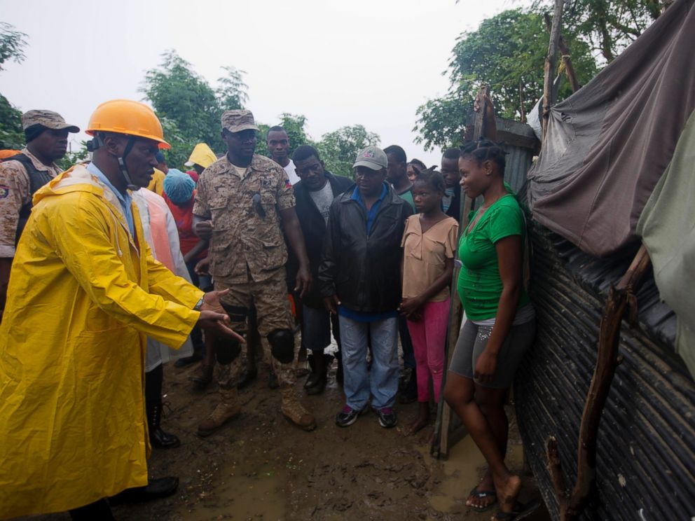 PHOTO: A civil protection worker, left, asks residents to evacuate the area near the Grise river, prior the arrival of Hurricane Matthew, in Tabarre, Haiti, Oct. 3, 2016.