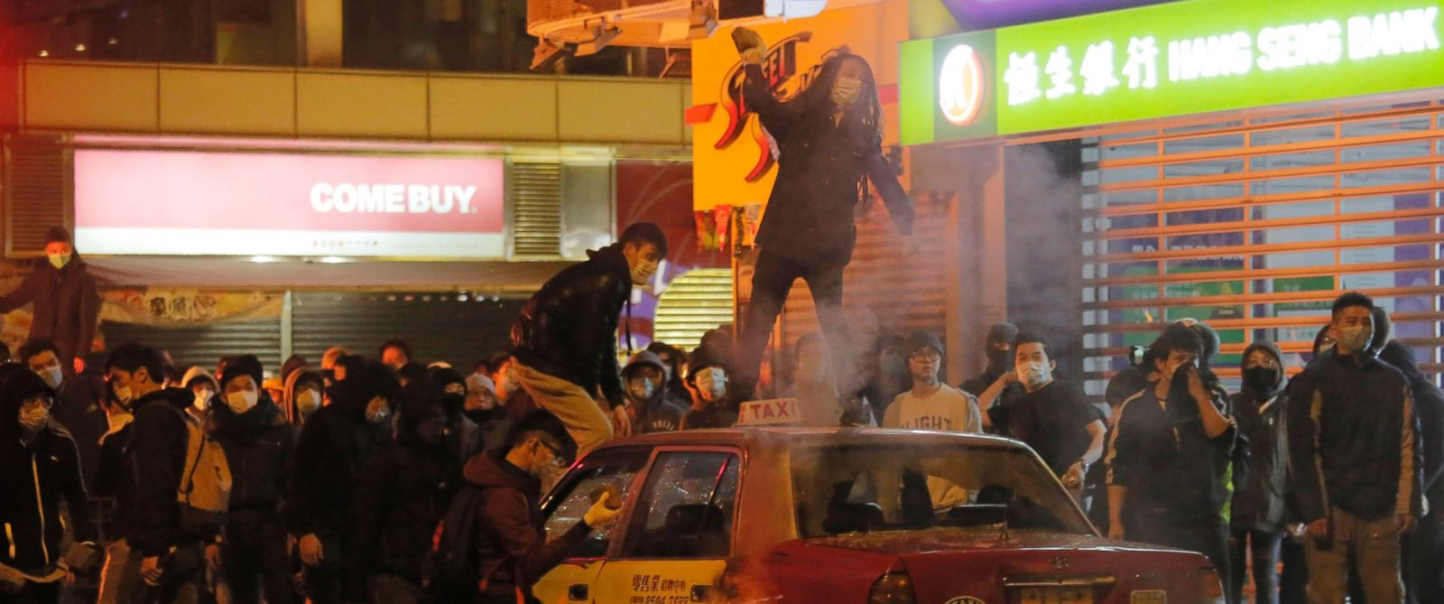 PHOTO: Rioters throw bricks at police in Mong Kok district of Hong Kong, Feb. 9, 2016.