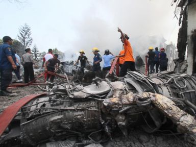 PHOTO: Firefighters and military personnel work at the site where an Air Force cargo plane crashed in Medan, North Sumatra, Indonesia, June 30, 2015.