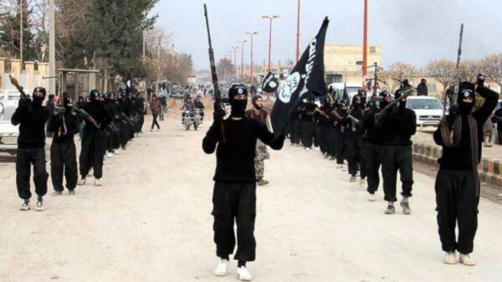 PHOTO: This undated file image posted on a militant website on Jan. 14, 2014, shows fighters from the al Qaida-linked Islamic State of Iraq and the Levant (ISIL) marching in Raqqa, Syria.