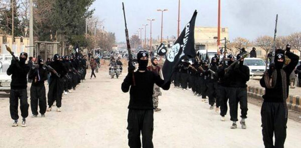 PHOTO: This undated file image posted on a militant website on Tuesday, Jan. 14, 2014 shows fighters from the al-Qaida linked Islamic State of Iraq and the Levant (ISIL) marching in Raqqa, Syria.