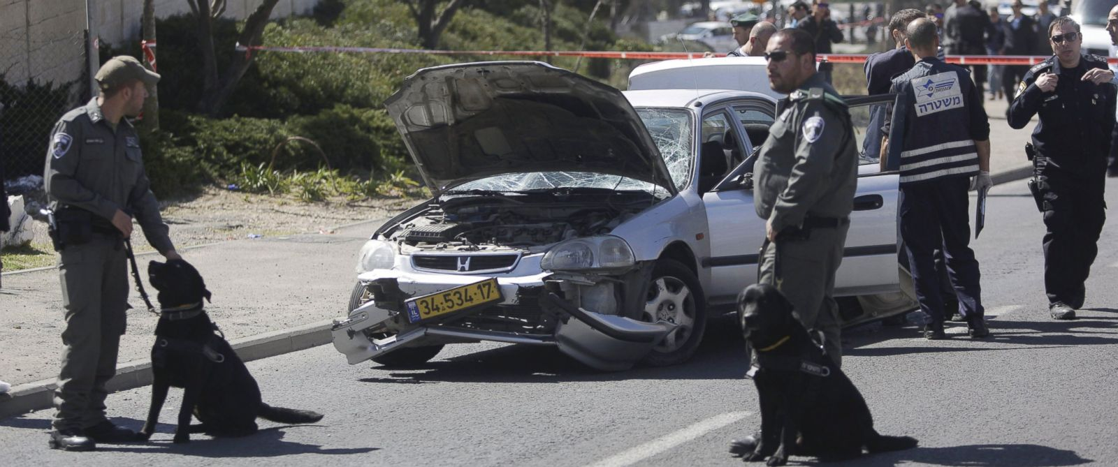 PHOTO: Israeli police stand next to a car at the scene of an attack in Jerusalem, March 6, 2015.