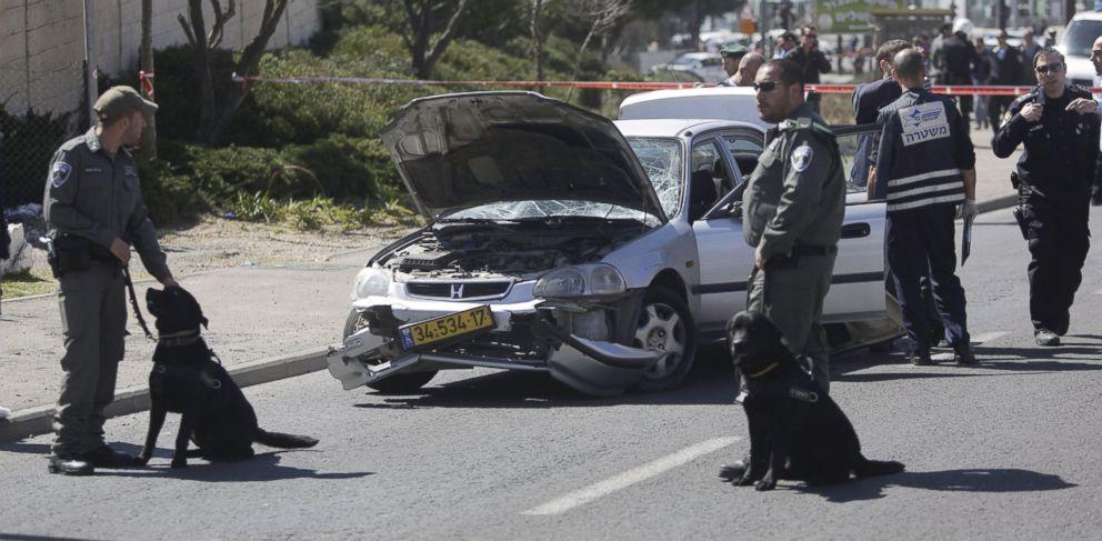 PHOTO: Israeli police stand next to a car at the scene of an of an apparent attack in Jerusalem, March 6, 2015.