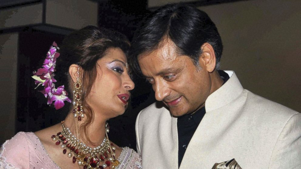 PHOTO: Former Indian Junior Foreign Minister Shashi Tharoor listens to his wife Sunanda Pushkar at their wedding reception in New Delhi, India, in this Sept. 4, 2010 file photo.