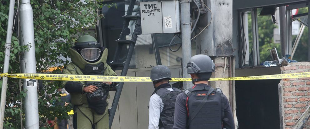 PHOTO: Members of the police bomb squad inspect a police post where an explosion went off in Jakarta, Indonesia, Jan. 14, 2016.