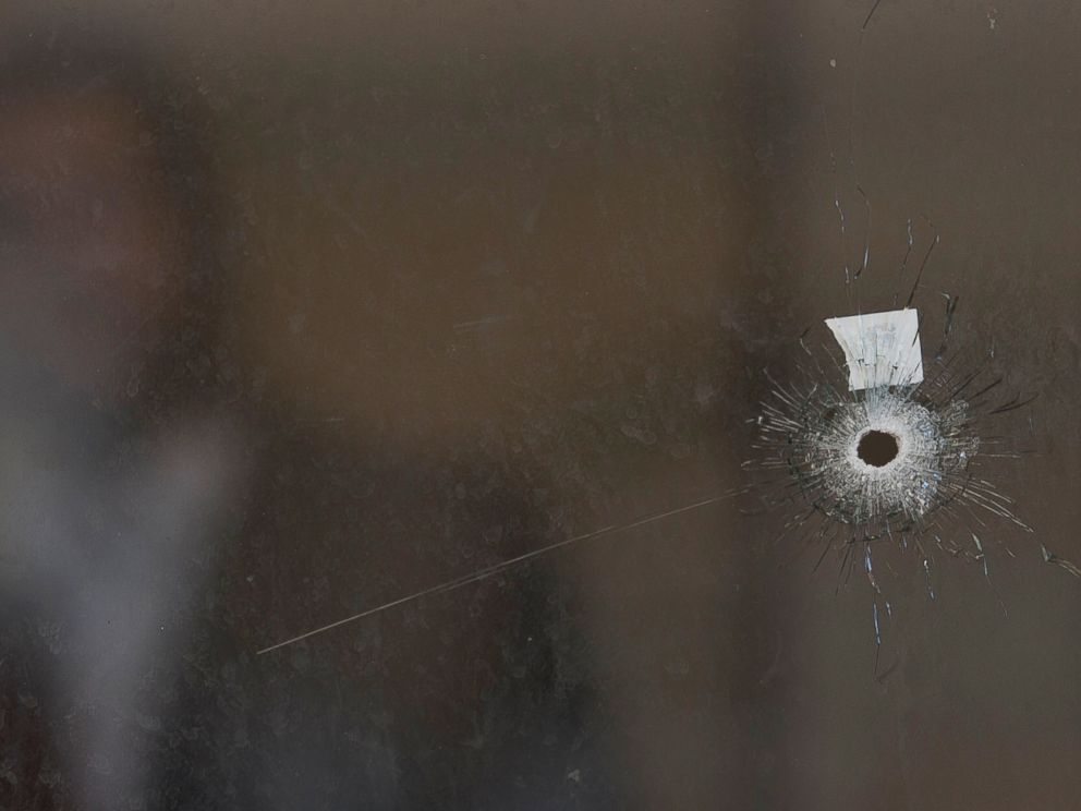 PHOTO: A bullet hole and forensic evidence are seen in side the Synagogue at the site of an attack in Jerusalem, Nov. 18, 2014.