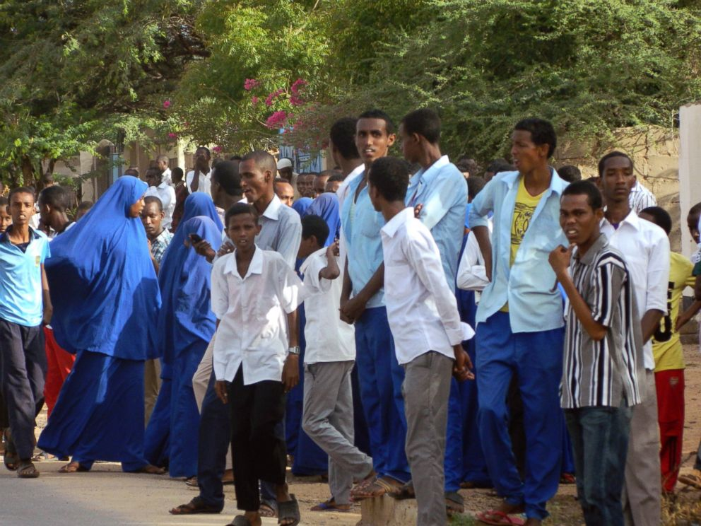PHOTO: Students gather and watch from a distance outside the Garissa University College after an attack by gunmen, in Garissa, Kenya, April 2, 2015.