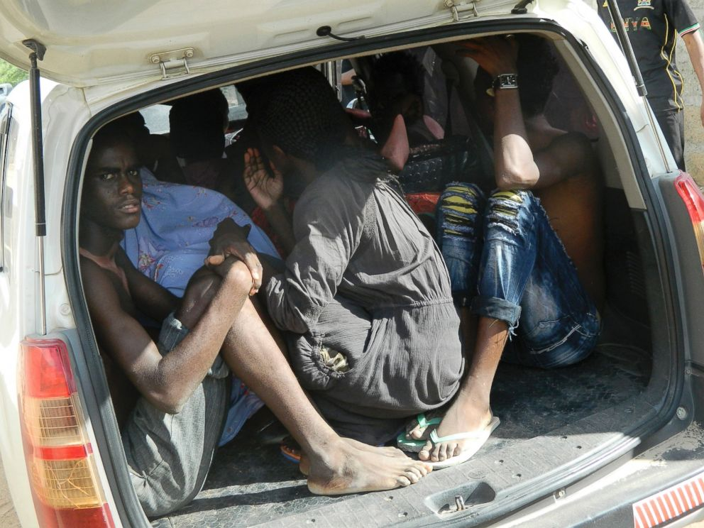 PHOTO: Students of the Garissa University College take shelter in a vehicle after fleeing from an attack by gunmen in Garissa, Kenya, April 2, 2015.