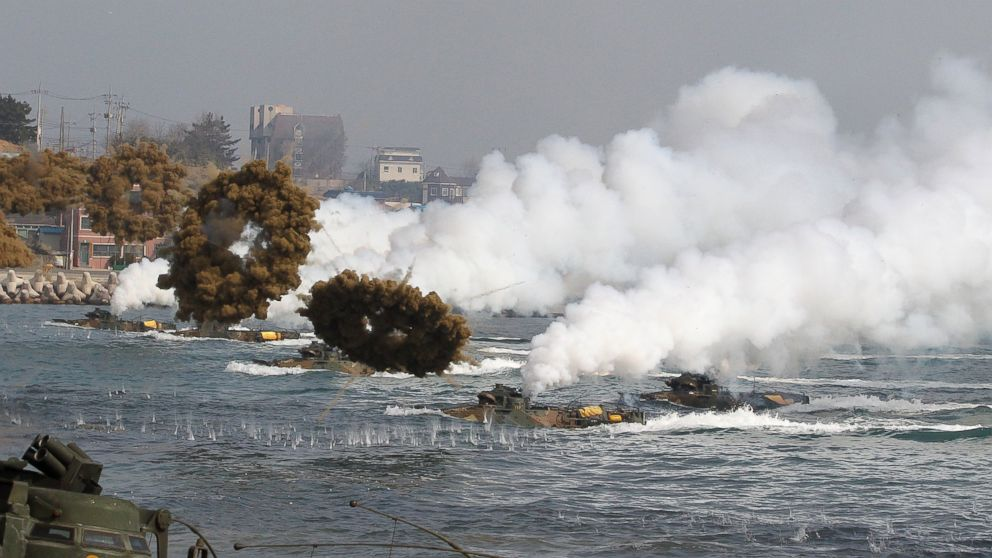 PHOTO: South Korean marine LVT-7 landing craft sail to shores through smoke screens during the U.S.-South Korea joint military exercises called Ssangyong, part of the Foal Eagle military exercises, in Pohang, South Korea, March 31, 2014.